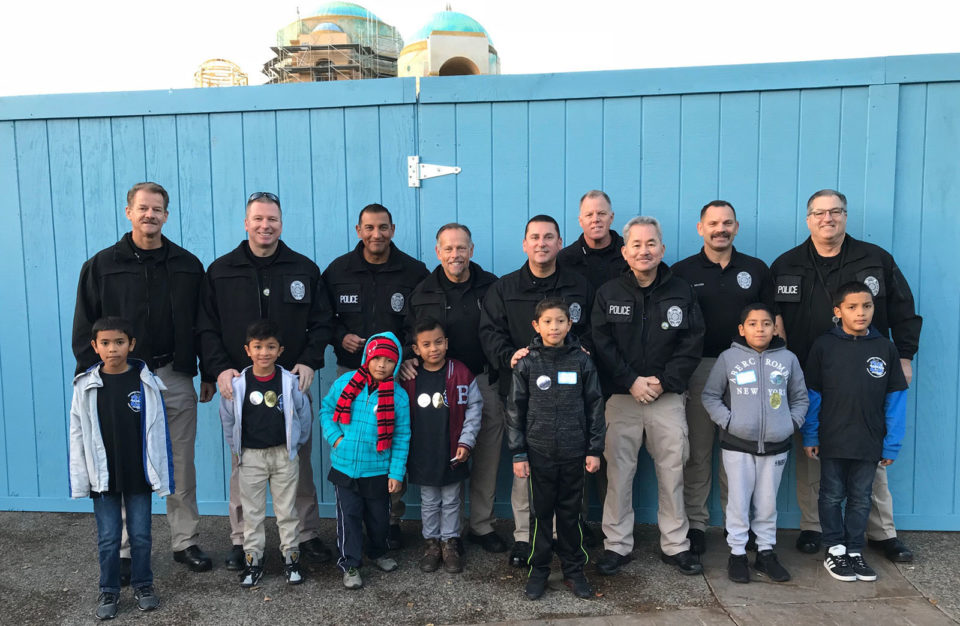 San Diego County District Attorney investigators each paired up with a child for a special holiday treat.