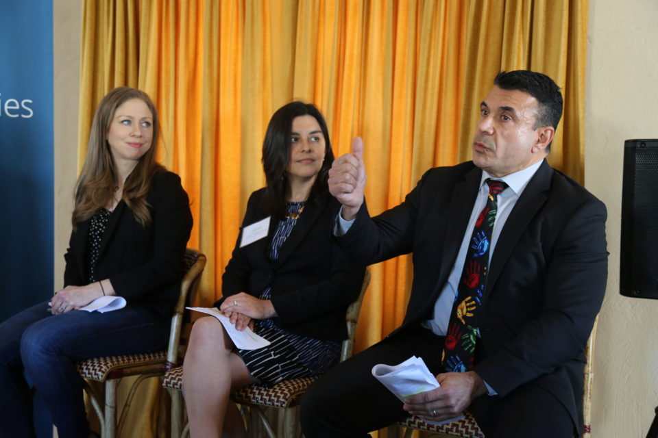 Chelsea Clinton, left, and Amy Aparicio Clark, Aetna Foundation managing director of community impact and strategy, listen when San Diego County HHSA Director Nick Macchione makes a point during a roundtable discussion on child welfare and juvenile justice Thursday.