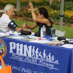 An HHSA Public Health Nurse checks a gentleman's blood pressure