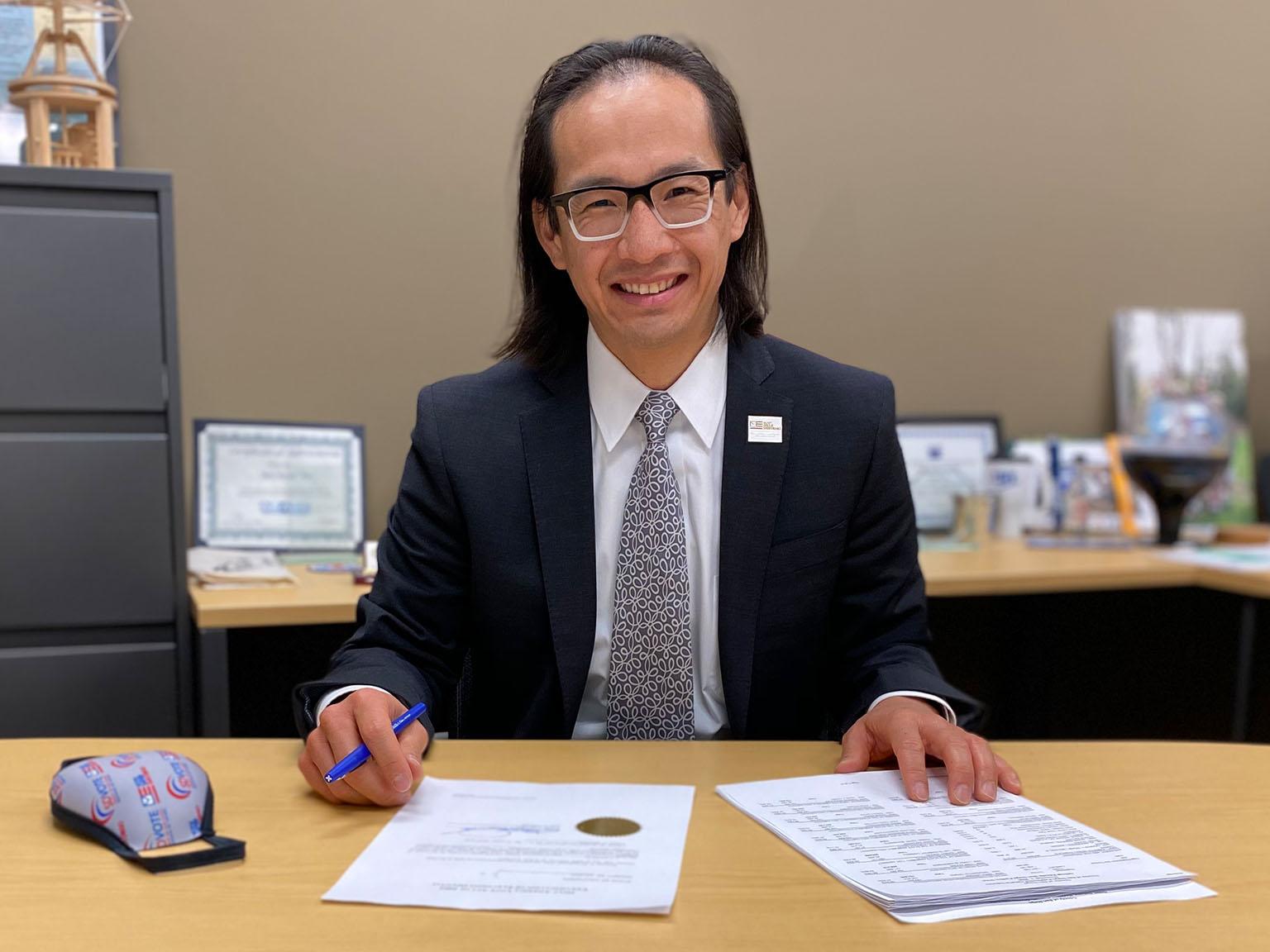 Michael Vu sitting at desk