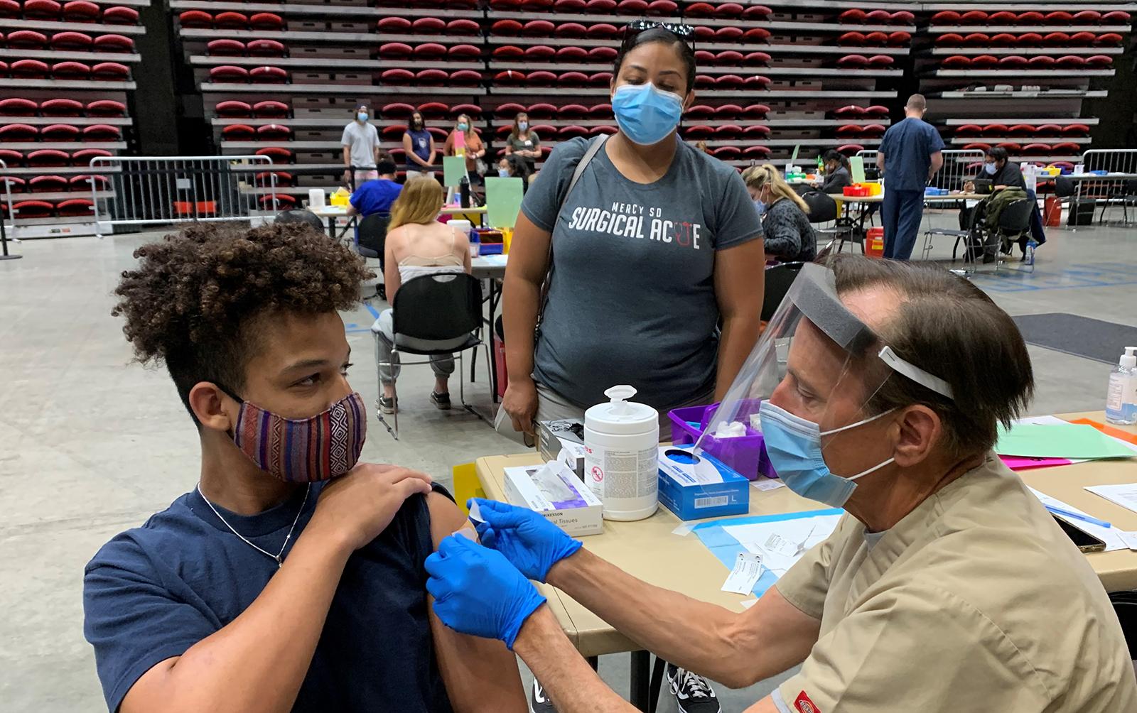 Teenage boy gets his COVID-19 vaccination.