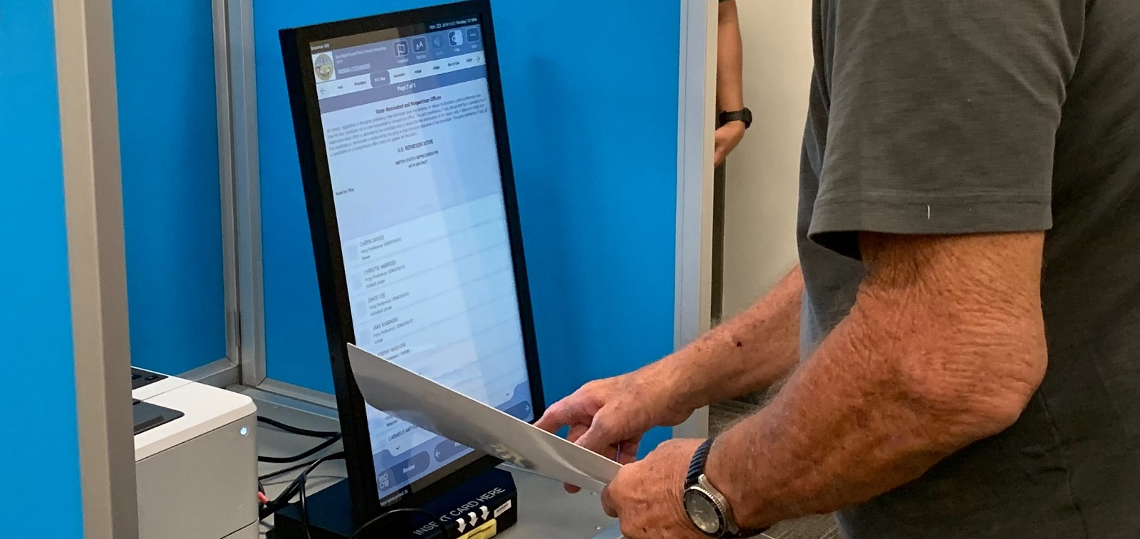 a person using a ballot marking device