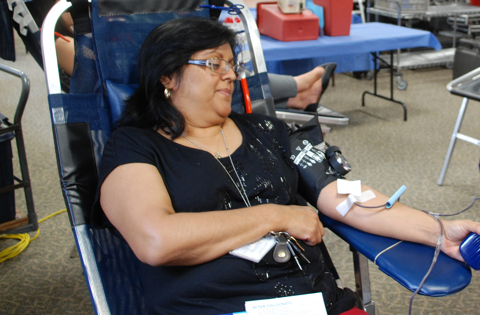 Susan Azhocar from the County Assessor/Recorder/County Clerk donates blood.