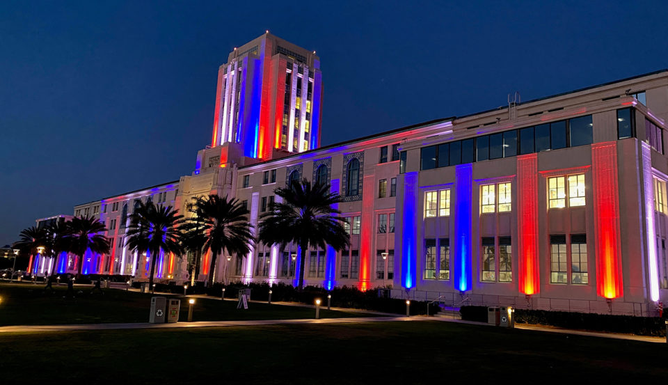 The County Administration Center is lit up in red, white and blue.
