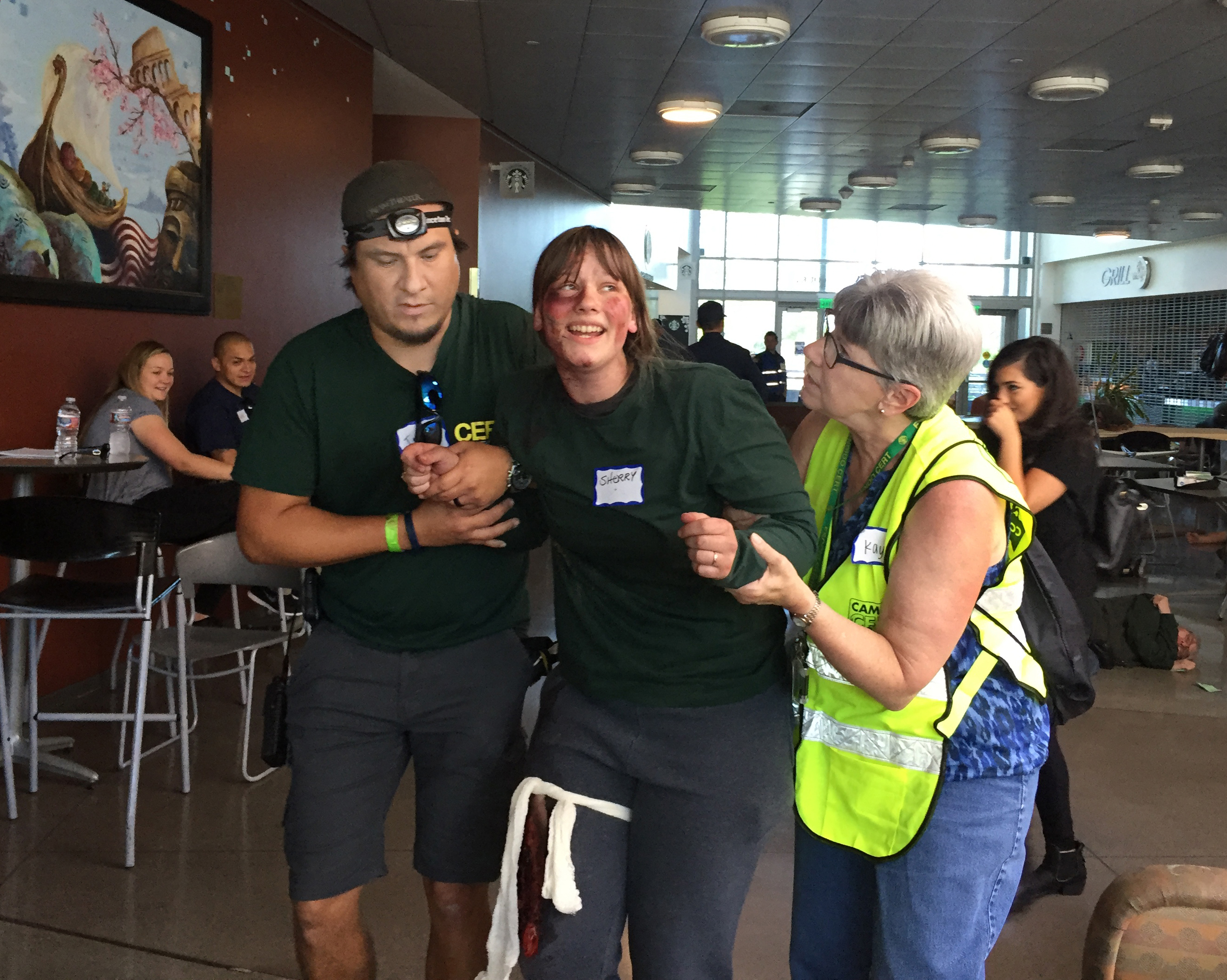 CERT members used basic first aid skills, then helped a mock victim to safety during a regional training exercise.