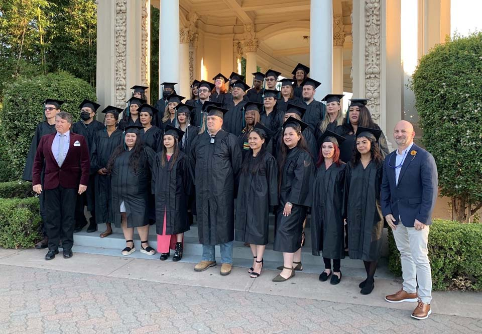 a group of graduates in cap and gown