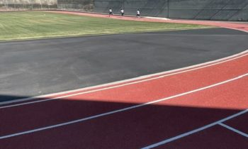 Justice-involved youth running on a new running track