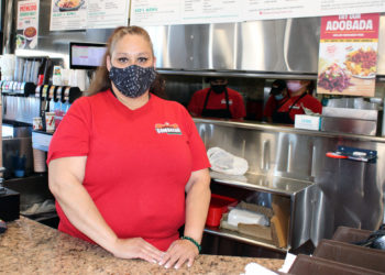 Angela Carapia stands at restaurant counter