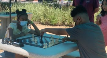 children playing chess outside