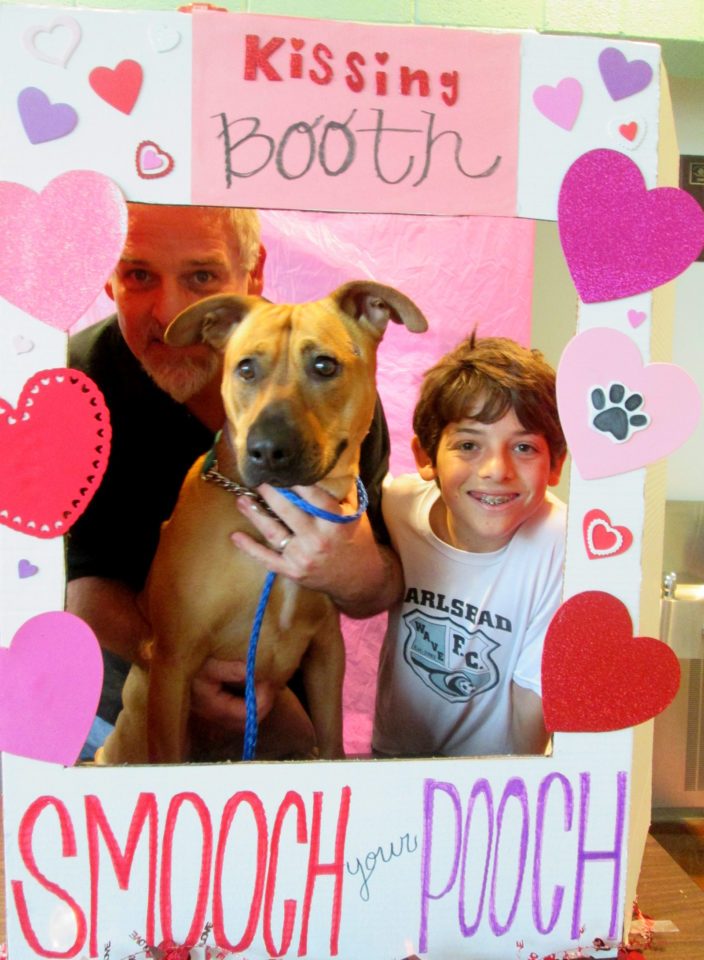 Steve Gardner and his son with their newly adopted dog.