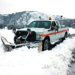 Department of Public Works plow trucks clear the roads.