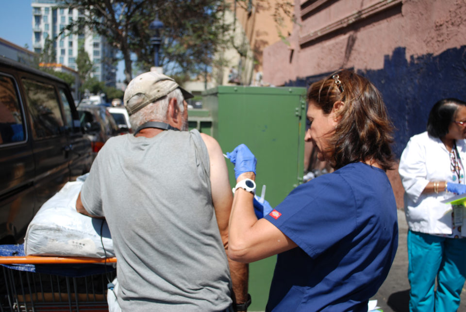 A San Diego County Public Health Nurse gives a vaccination as part of the Homeless Outreach Team efforts to stop the spread of Hepatitis A.