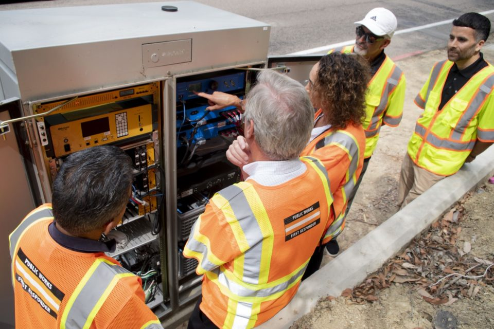public work employees look at a new backup battery system