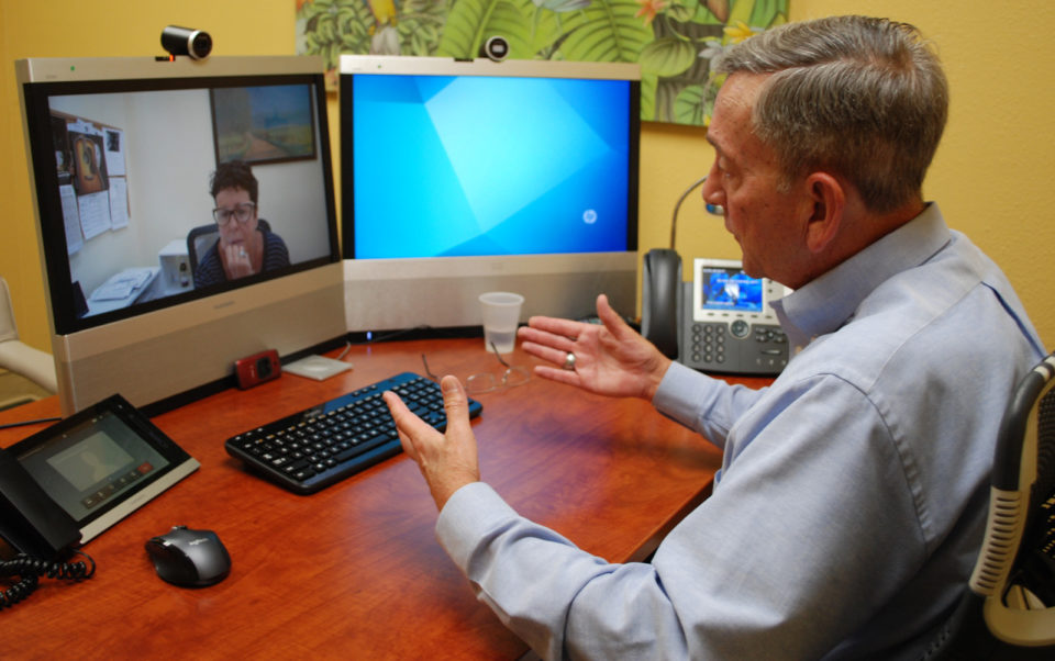 Psychiatrist Douglas Conte demonstrates how telepsychiatry works with a colleague in Escondido.