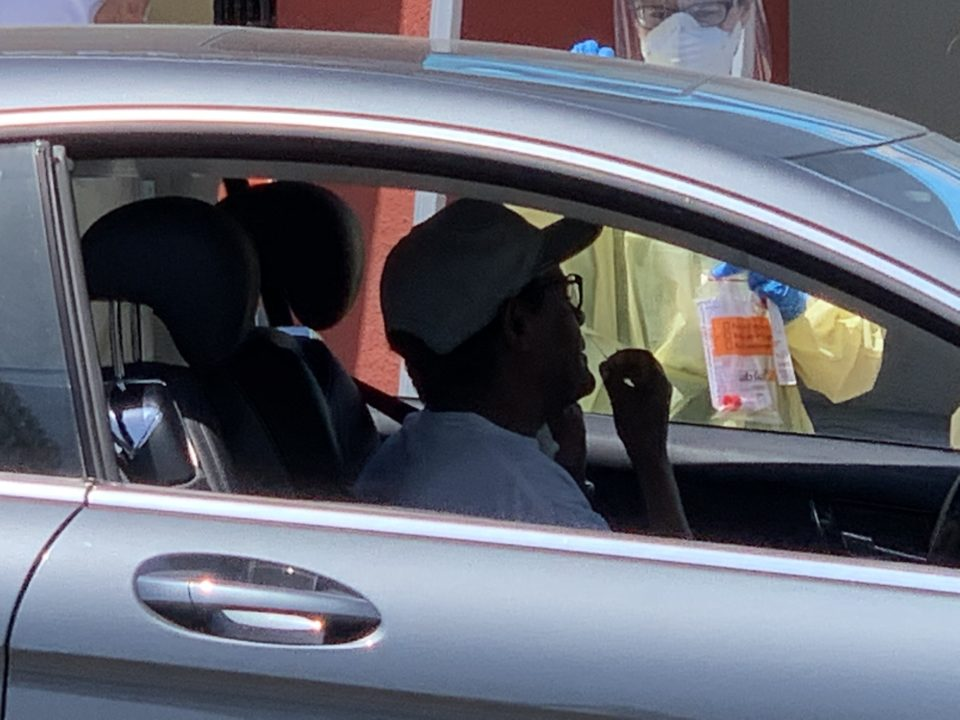 Man in car at COVID-19 test site