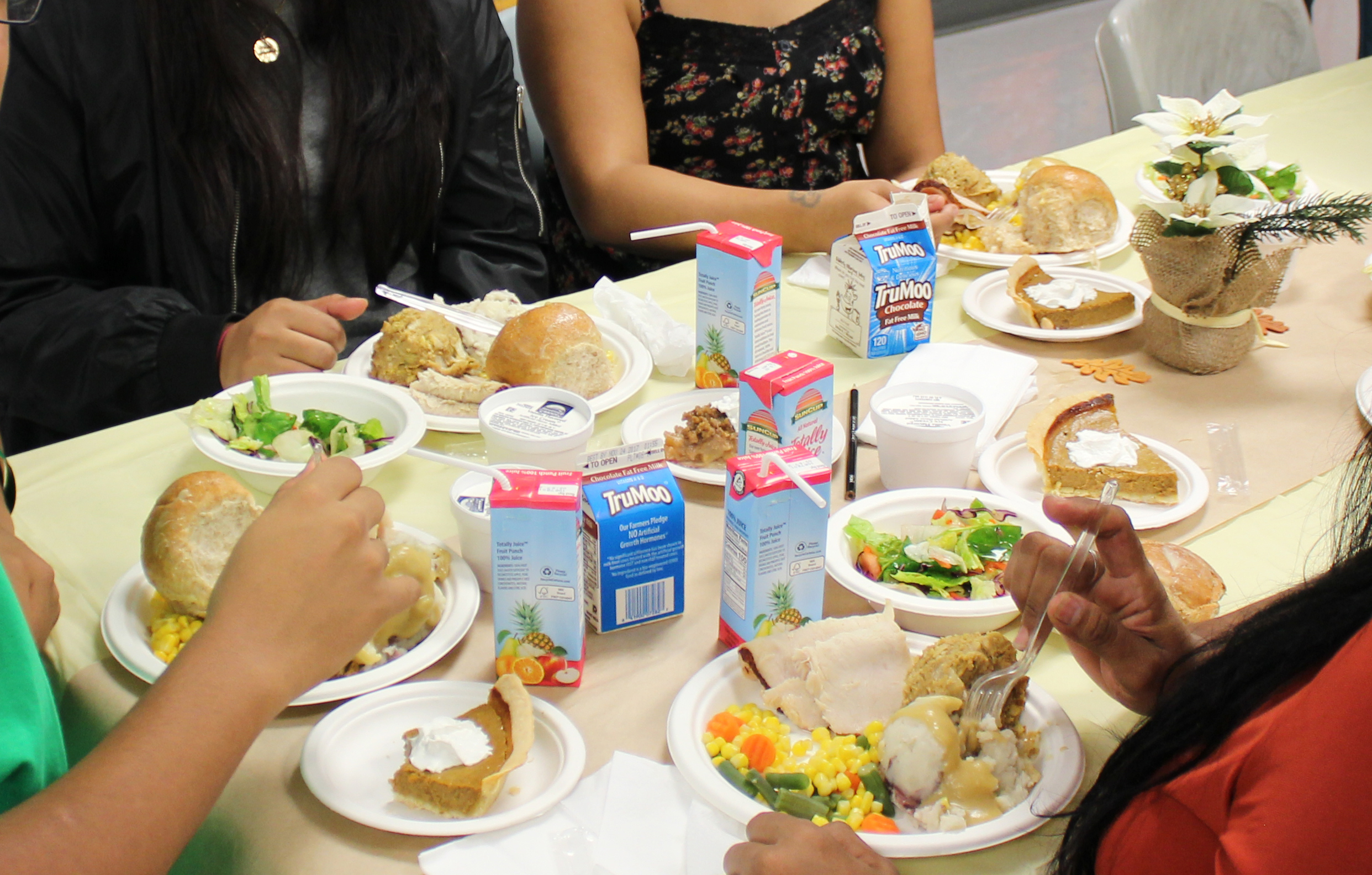Young men in Probation's custody share a holiday meal with their family to keep them connected with their support system.