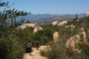 Hikers trek through El Capitan Preserve.