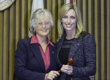 Dianne Jacob passes the gavel to Kristin Gaspar