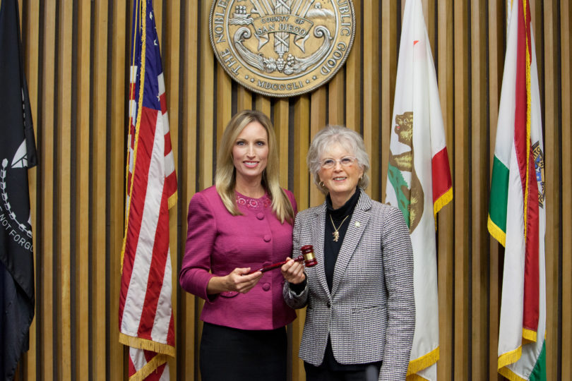 Supervisor Kristin Gaspar passes the gavel to Chairwoman Dianne Jacob.