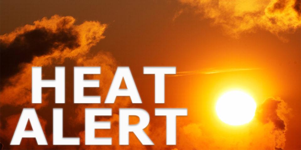 Heat Alert text written over orange sky