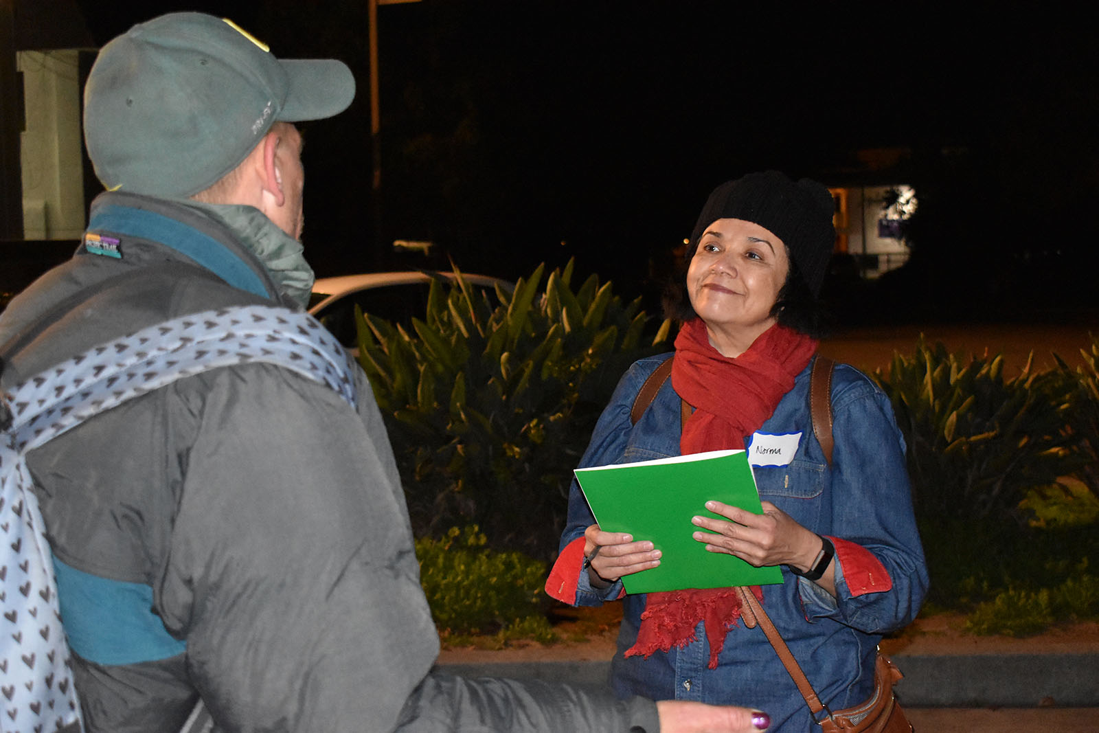 Norma Diaz, a human services specialist with the County HIV/STD Outpatient Clinic, interviews a homeless man.