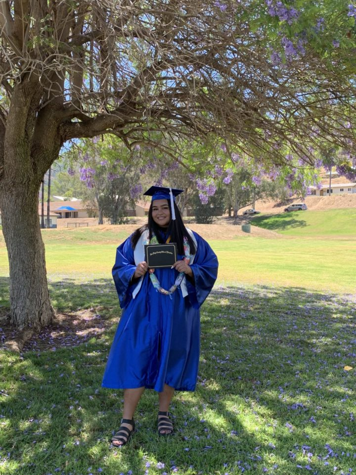 A girl in a cap and gown