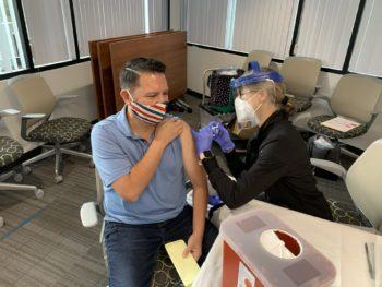 A County employee gets a flu shot