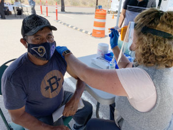 An El Cajon man gets his COVID-19 vaccine at a mobile clinic.