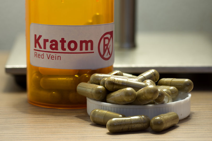 Image of actual kratom pills with a faux prescription logo.