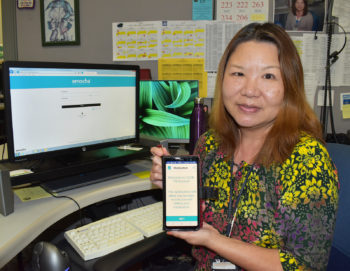 Krystal Liang, public health nurse supervisor with the County Tuberculosis Control Program, shows the app patients use to record and upload videos of them taking their medication.