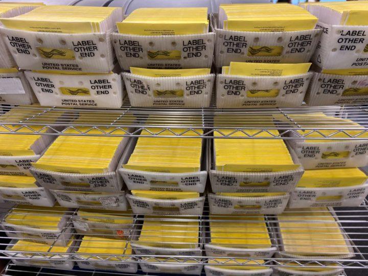 returned mail ballots on shelves
