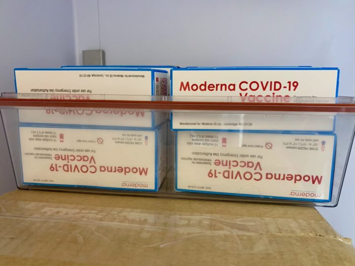 Boxes of vaccine on a table