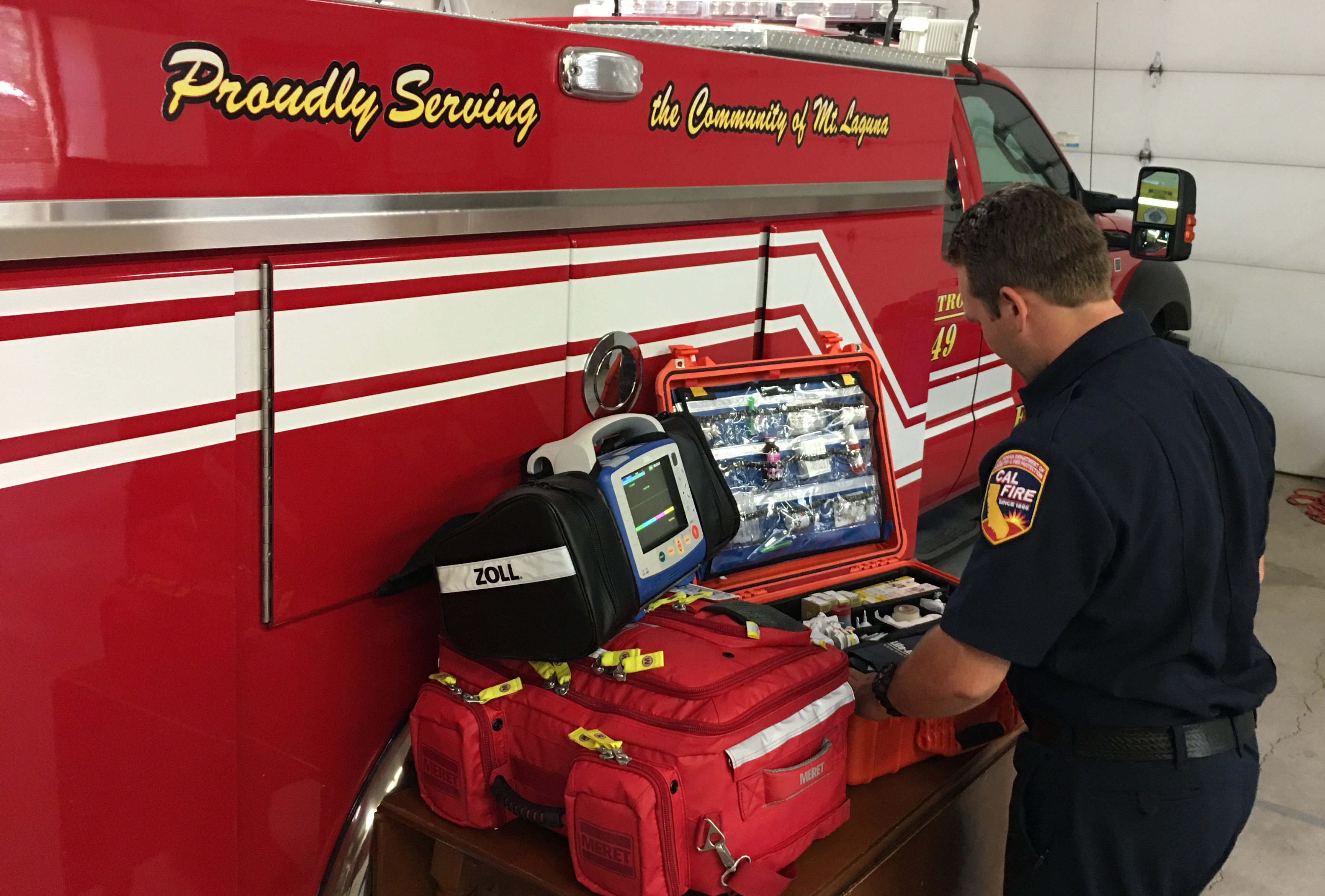 Firefighter Paramedic Brenton Rowell from the Mt. Laguna County Fire Station is completing his morning checks of the Advanced Life Support gear.