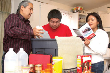 September is National Preparedness Month. A family puts together an emergency preparedness kit.