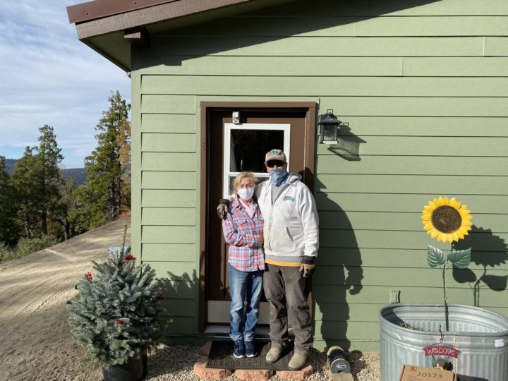 The Weir family stand by door with secure key safe on the front door.