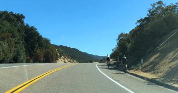 Bicyclists trekking along Old Highway 80 in bike lanes.