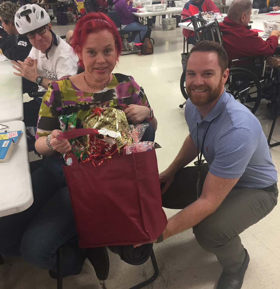 Deputy Public Administrator/Guardian Matthew Deeley delivers donated gifts to one of his clients last year. The PA/PG has an annual gift drive that collects holiday donations for vulnerable and at-risk County residents.