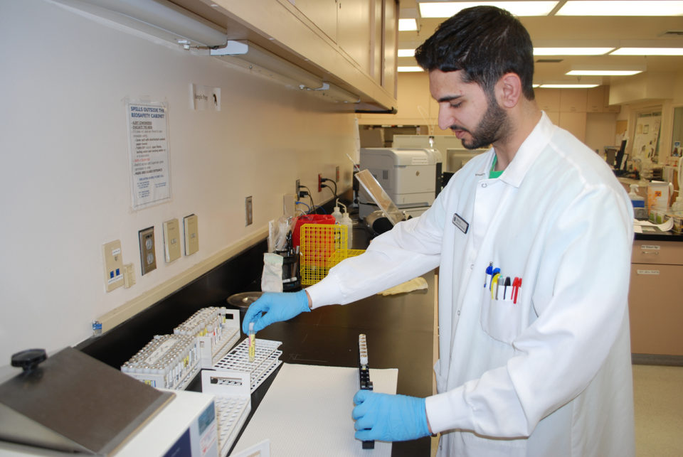 Microbiologist Patrick Aziz prepares samples to test for Zika.