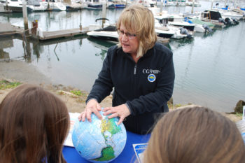Engineering geologist Cindy Pridmore talks to students about what causes a tsunami.