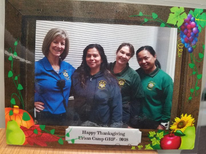 Probation officers organized a Thanksgiving meal for detained girls and their families at the Kearny Mesa Juvenile Detention Facility. They took pictures of each family and gave them a framed keepsake such as this one.