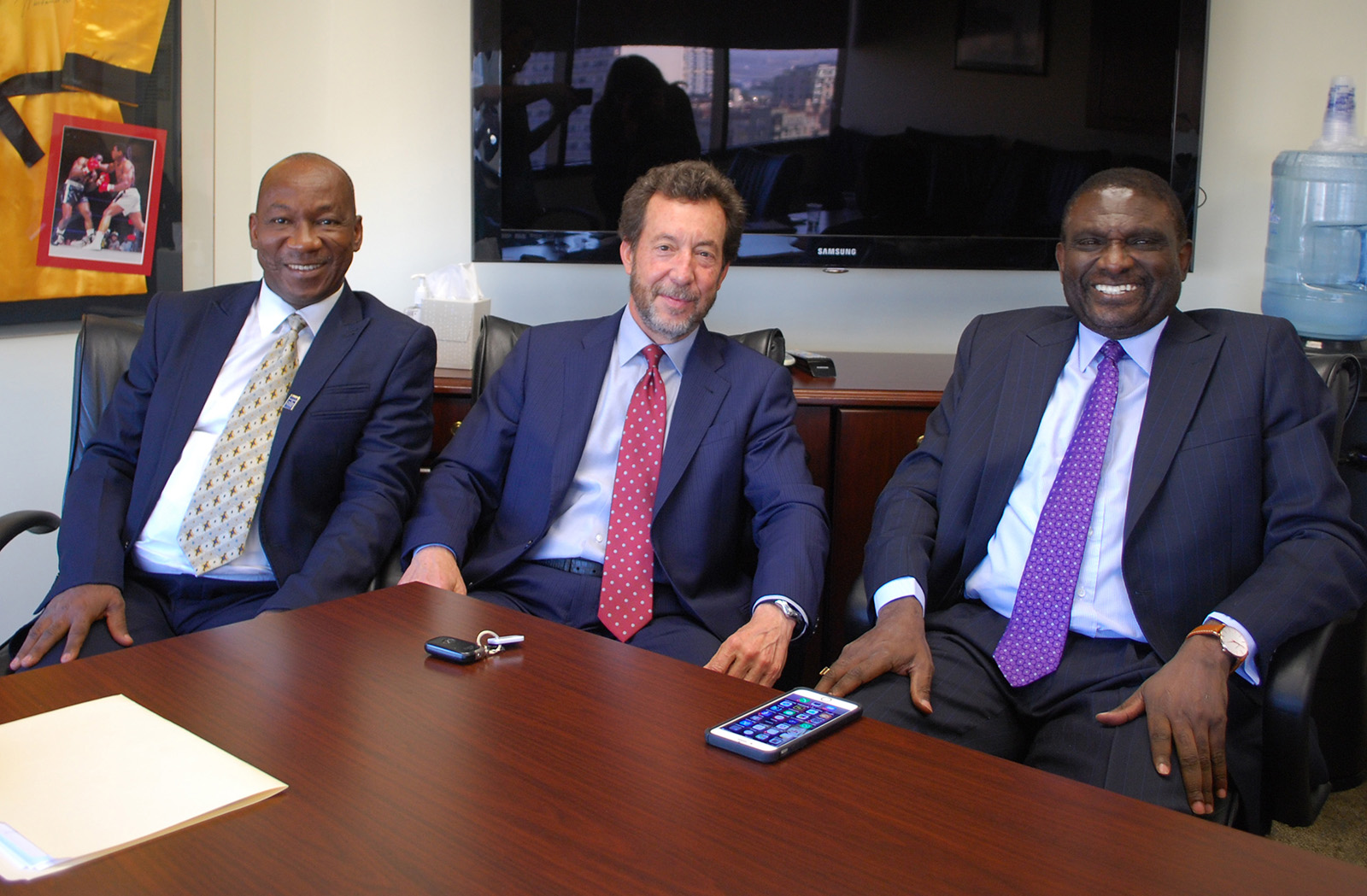 Nigerian Barrister Abdullahi Wahab Zakari, at left, meets with Public Defender Randy Mize, center, and retired Public Defender Henry Coker to discuss how the County Public Defender's Office operates in collaboration with San Diego County's  legal community.
