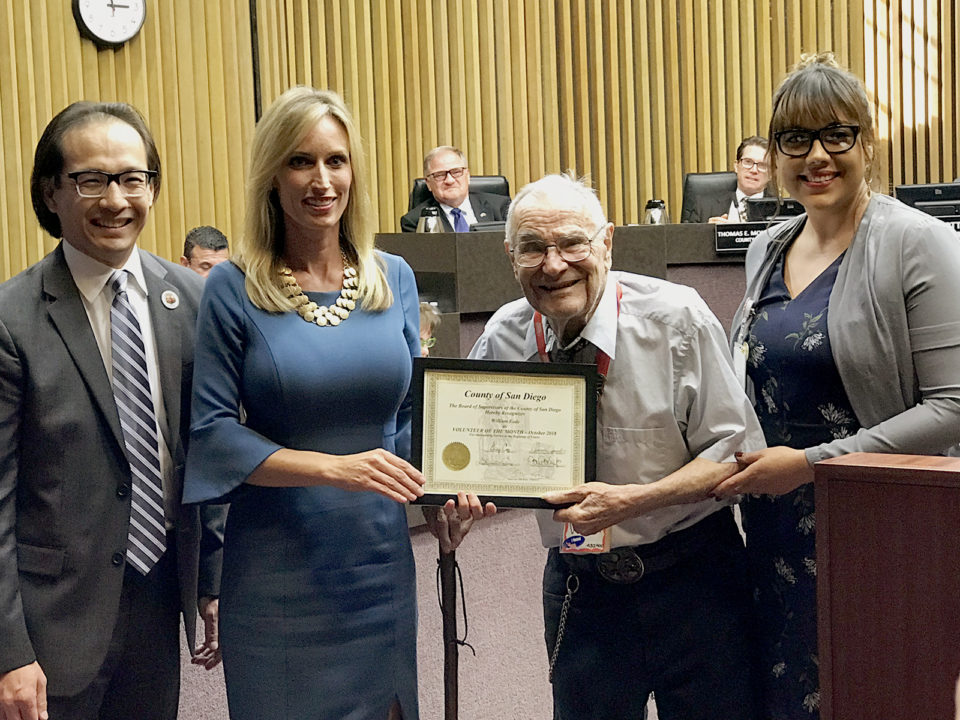 From left to right: Registrar of Voters Michael Vu,  Board Chairwoman Kristin Gaspar, Volunteer of the Month William Eade and Registrar of Voters Volunteer Services Coordinator Vanessa Perez.