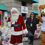 Santa waves to all the boys and girls at Rady Children's Hospital.