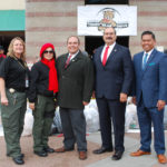 A San Diego County Probation team smiles in front of teddy bears.