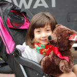 4-year-old Mia watched law enforcement officers bring bag after bag of stuffed animals.