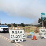 The California Highway Patrol guards the entrance to the fire area at Cameron Corners.