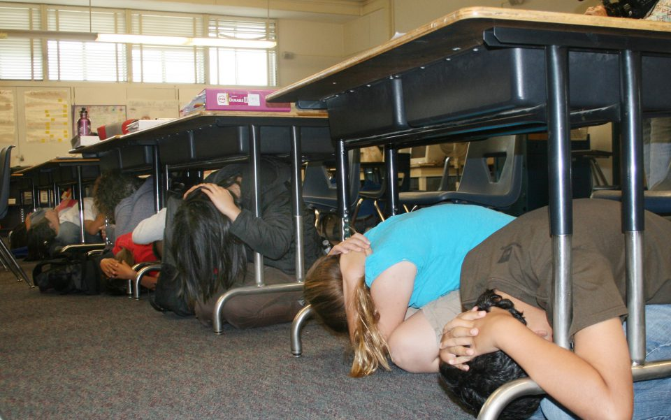 Students practice Drop, Cover, and Hold On as part of the Great California ShakeOut.