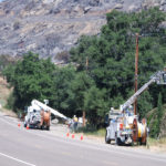 Dozens of utility trucks working to return electricity to the area.