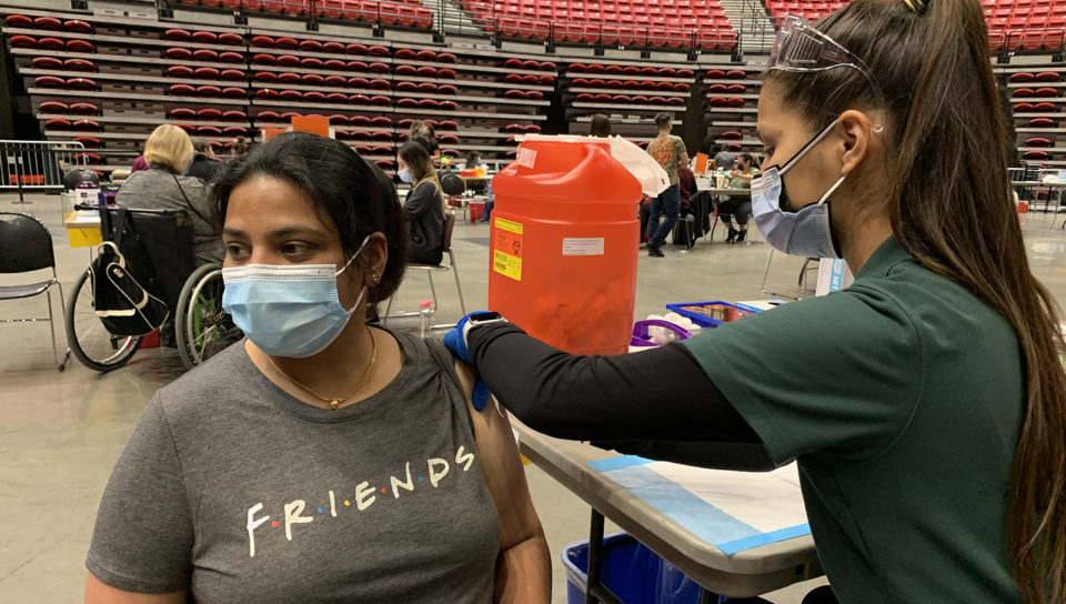 one woman vaccinates another woman