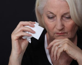 woman holding tissue